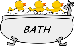 Image of a bath tub with rubber ducks.